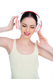 Happy young woman listening to music Royalty Free Stock Images