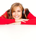 Happy young woman listening to music Royalty Free Stock Photos