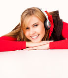Happy young woman listening to music Stock Images