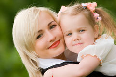 Happy young woman with little daughter Royalty Free Stock Photo