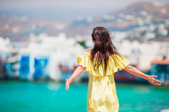 Happy young woman at Little Venice the most popular tourist area on Mykonos island, Greece. Beautiful girl enjoy greek Stock Image