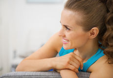 Happy young woman in living room looking on copy space Royalty Free Stock Images