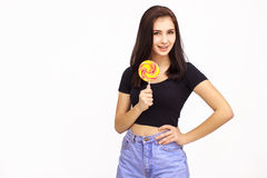 Happy Young Woman with lolipop. Isolated On White Background Royalty Free Stock Photography