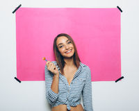 Happy young woman with lollipop Stock Image