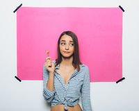 Happy young woman with lollipop Stock Photo
