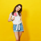 Happy young woman with lollipop stock photos