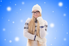 Happy young woman with long hair in warm winter clothes over chr Stock Photos