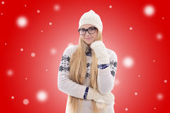 Happy young woman with long hair in warm winter clothes over red Stock Photo