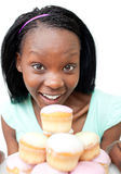 Happy young woman looking at cakes Stock Photography