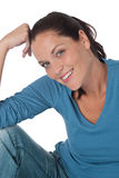 Happy young woman looking at camera Stock Images