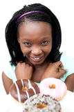 Happy young woman looking at donuts Royalty Free Stock Image