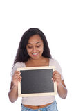 Happy Young Woman Looking at her Empty Small Board Royalty Free Stock Images