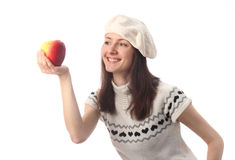 Happy young woman looking at juicy red apple Stock Photography