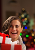Happy young woman looking out from Christmas gift Stock Photography