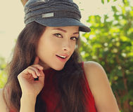 Happy young woman looking with smile in hat Royalty Free Stock Images
