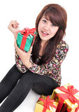 Happy young woman with lots of gifts Stock Photography