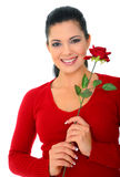 Happy Young Woman In Love. Attractive woman holding red rose smiling. isolated on white royalty free stock photography