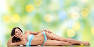 Happy young woman lying in bikini swimsuit Royalty Free Stock Photography