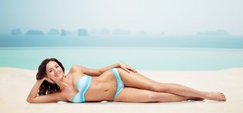 Happy young woman lying in bikini swimsuit Stock Photography