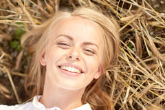 Happy young woman lying on cereal field Royalty Free Stock Photo