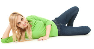 Happy young woman lying on the floor Stock Image