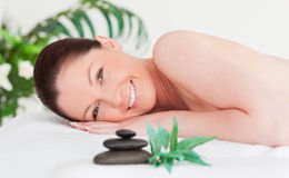 Happy young woman lying on her belly Royalty Free Stock Photography
