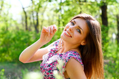 Happy young woman lying on a meadow in summer day Royalty Free Stock Photos