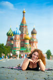 Happy young woman lying on Red Square Royalty Free Stock Photo