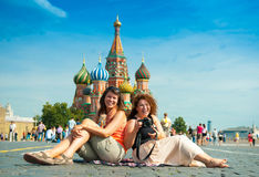 Happy young woman lying on Red Square Royalty Free Stock Image