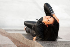 Happy young woman lying on the sidewalk Royalty Free Stock Photography