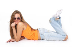 Happy young woman lying in sunglasses Stock Image