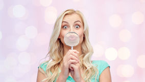 Happy young woman with magnifying glass Royalty Free Stock Images