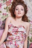 Happy young Woman with Make-up. And Curly Hair style. Beautiful Girl in Flower cloth Royalty Free Stock Image