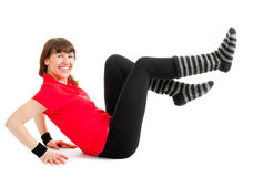 Happy young woman makes fitness exersises Stock Image
