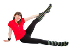 Happy young woman makes fitness exersises Royalty Free Stock Images