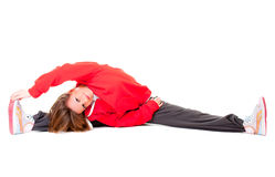 Happy young woman makes stretching exersises Royalty Free Stock Image
