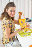 Happy young woman making easter basket Stock Photos