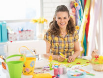 Happy young woman making easter decoration Stock Image