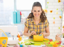 Happy young woman making easter decoration Royalty Free Stock Photo