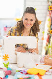 Happy young woman making easter pot holder mitts Royalty Free Stock Photo
