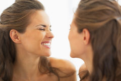 Happy young woman making funny face in mirror Royalty Free Stock Image