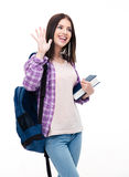 Happy young woman making greeting gesture with palm Stock Photo