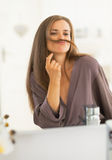 Happy young woman making mustache with hair Stock Image