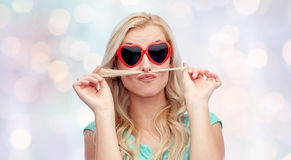 Happy young woman making mustache with her hair Stock Photo