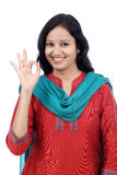 Happy young woman making Ok gesture Stock Photography
