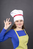 Happy young woman  making OK sign over Stock Photos