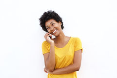 Happy young woman making a phone call Stock Image
