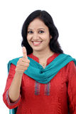 Happy young woman making thumbs up gesture Stock Photography