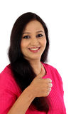 Happy young woman making thumbs up gesture Stock Photos