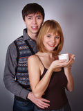 Happy young woman and man with cup of tea Stock Photography